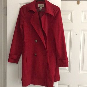 Red long double breasted trench coat.